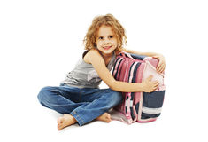 Portrait of smiling school girl hugging rucksack Stock Images