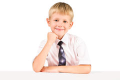 Portrait of smiling  schoolboy at table Stock Images