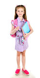 Portrait of smiling schoolgirl with books and backpack isolated Royalty Free Stock Photo