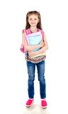 Portrait of smiling schoolgirl with books and backpack isolated Stock Images