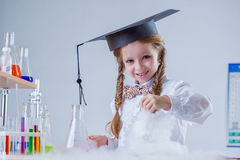 Portrait of smiling schoolgirl in chemistry lab Stock Photo