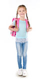 Portrait of smiling schoolgirl with school bag Stock Photo