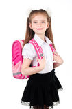 Portrait of smiling schoolgirl in uniform with backpack isolated Stock Photo