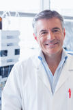 Portrait of a smiling scientist wearing lab coat Stock Image
