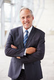 Portrait of smiling senior corporate businessman, standing Stock Photography