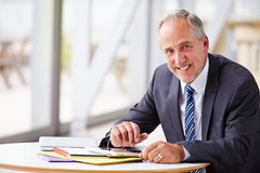 Portrait of smiling senior corporate businessman, waist up Stock Image