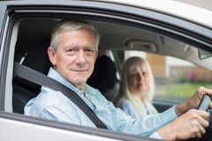 Portrait Of Smiling Senior Couple On Car Journey Together Royalty Free Stock Images