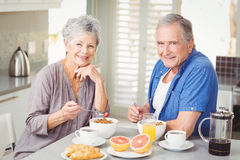 Portrait of smiling senior couple having breakfast Royalty Free Stock Photo