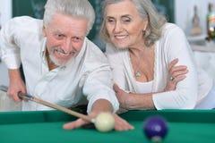 Senior couple playing billiard Royalty Free Stock Photo