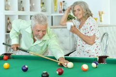 Senior couple playing billiard Royalty Free Stock Photo