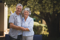 Portrait of smiling senior couple standing in backyard Royalty Free Stock Images