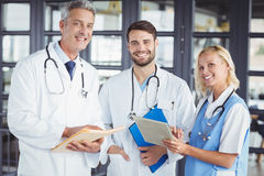 Portrait of smiling senior doctor with coworkers Stock Images