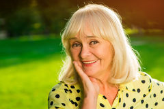 Portrait of smiling senior female. Royalty Free Stock Images