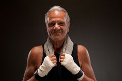 Portrait of a smiling senior fighter with a towel Royalty Free Stock Photos