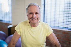 Portrait of smiling senior male patient against window Stock Images