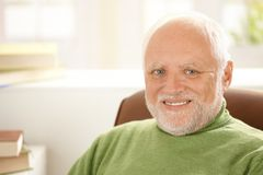 Portrait of smiling senior man. With white hair, looking at camera Royalty Free Stock Photography