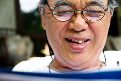 Portrait of smiling senior man with book Royalty Free Stock Image