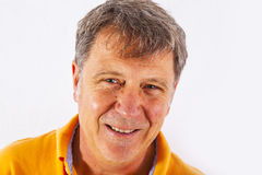 Portrait of a smiling senior man. Portrait of cute handsome man with a positive friendly expression Stock Photo