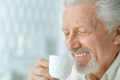 Senior man drinking coffee Royalty Free Stock Photography