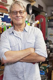 Portrait of smiling senior man with glasses and arms crossed Royalty Free Stock Images