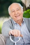 Portrait Of Smiling Senior Man Holding Walking Royalty Free Stock Images