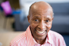 Portrait of smiling senior man with receding hairline. At nursing home stock photography