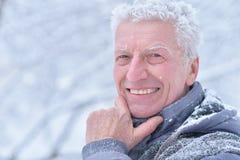 Senior man standing outdoors Royalty Free Stock Image
