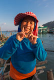 Portrait of smiling senior Thai Asian woman at the harbor of Ban Royalty Free Stock Image