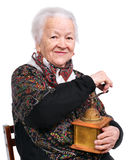 Portrait of a smiling senior woman. With grinder on a white background stock image