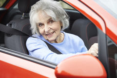 Portrait Of Smiling Senior Woman Driving Car Stock Images