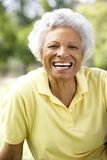 Portrait Of Smiling Senior Woman Outdoors Stock Photo
