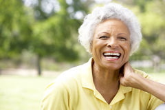 Portrait Of Smiling Senior Woman Outdoors Stock Photos