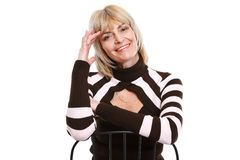 Portrait of smiling senior woman sitting on chair Stock Photography