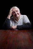 Portrait of a smiling senior woman. Studio shot over black background Stock Photography
