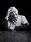 Portrait of a smiling senior woman. Studio shot over black background Stock Photo