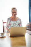 Portrait of smiling senior woman using a laptop Royalty Free Stock Photography
