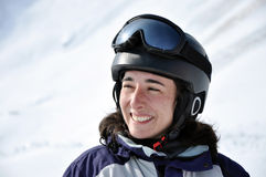 Portrait of a smiling skier woman with helmet Royalty Free Stock Image