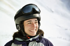 Portrait of a smiling skier woman with helmet Stock Images