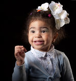 Portrait smiling small girl on black background Stock Photos