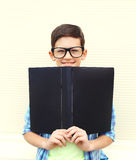 Portrait smiling smart teenager boy in glasses with folder or book. Over white background Royalty Free Stock Images
