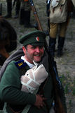 Portrait of a smiling soldier-reenactor. Royalty Free Stock Photo
