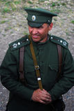 Portrait of a smiling soldier-reenactor. Stock Image