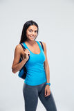 Portrait of a smiling sporty woman with backpack Stock Image