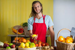 Portrait of smiling staff standing at counter Stock Images