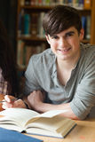 Portrait of a smiling student. In a library Stock Image