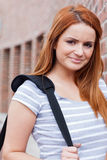 Portrait of a smiling student. Looking at the camera outside a building Royalty Free Stock Photo