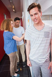 Portrait of smiling student with friends behind him Royalty Free Stock Photography