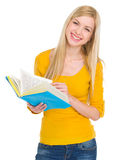 Portrait of smiling student girl with book Royalty Free Stock Image