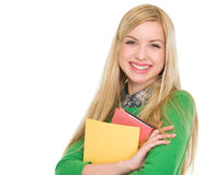 Portrait of smiling student girl with books Stock Photo