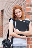 Portrait of a smiling student holding her binder Royalty Free Stock Photos